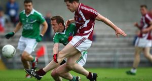 Westmeath's Callum McCormack shoots under pressure from Fermanagh's John Woods. Photograph: Ken Sutton/Inpho