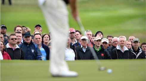Golf fans watching a putt on the 2nd at the final day of The Irish Open, in Carton House, Maynooth, Co. Kildare. Photo: Dara Mac Donaill / THE IRISH TIMES