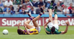 Meath's Michael Newman (right) and Wexford's  Brian Malone at Croke Park. Photograph: Donall Farmer/Inpho