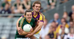 Meath's Séamus Kenny fends  off the challenge of Brian Malone of Wexford at Croke Park.  Photograph: Donall Farmer/Inpho