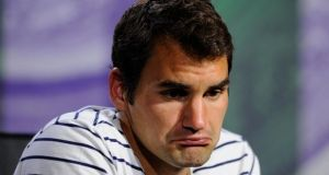 Roger Federer confronts the press following his shock defeat at Wimbledon last week. Photograph: Getty Images.
