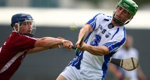 Waterford's Brian O'Sullivan shoots under pressure from Westmeath's John Shaw. Photograph: Ken Sutton/Inpho