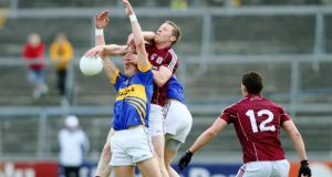 Steven O'Brien of Tipperary battles with Galway's Greg Higgins at Pearse Stadium. Photograph: Mike Shaughnessy/Inpho