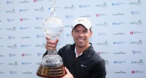 Paul Casey of England poses with the trophy after winning the Irish Open at Carton House. Photograph:   Andrew Redington/Getty Images