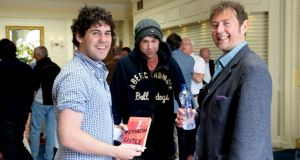 Author DBC Pierre meets Michael Tobin (left) and Thomas Mc Cabe from Moynalty, Co Meath during the Hay Festival  Kells on Saturday. Photograph: Cyril Byrne