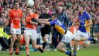 Armagh's Caolan Rafferty kicks the ball forward under prfessure from Wicklow players. Photograph: Matt Mackey/Presseye/ Inpho