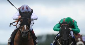 Johnny Murtagh rides Ambivalent to victory in the    Pretty Polly Stakes at  the Curragh. Photograph:  Alan Crowhurst/Getty Images)
