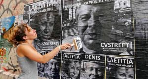 Laetitia, a 30-year-old unemployed Frenchwoman and member of CVStreet group, uses a brush to paste posters of herself and others unemployed people in the streets of Marseille. The main idea is to break the anonymity for the unemployed by posting their portraits in the street.