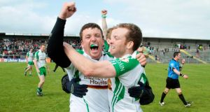 London's Sean Kelly and Danny Ryan celebrate after beating Leitrim in the Connacht SFC semi-final at Dr Hyde Park yesterday. Photograph: Mike Shaughnessy/Inpho