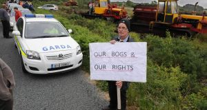 Des Guckian from Co Leitrim shows his support for the turf cutters at Monivea bog. Photograph: Ray Ryan