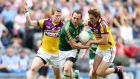Wexford's David Murphy and Brian Malone tackle Graham Reilly of Meath at Croke Parks yesterday. Photograph: Inpho