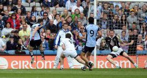 Bernard Brogan scores Dublin's second goal at Croke Park yesterday. Photograph: Donall Farmer/Inpho