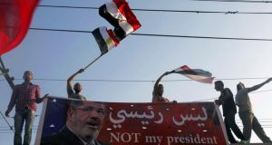 Protesters opposing Egyptian president Mohamed Morsi wave Egyptian flags and shout slogans against him and members of the Muslim Brotherhood, during a protest in front of El-Thadiya presidential palace in Cairo. Photograph: Amr Abdallah Dalsh/Reuters.