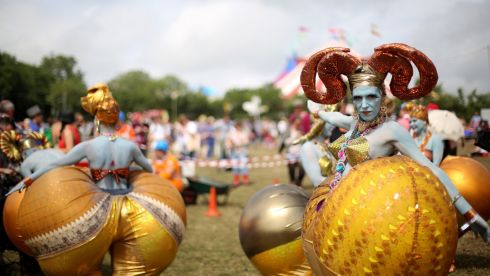 Performers at the Theatre Tent brought colour and imagination. Photograph: Matt Cardy/Getty Images