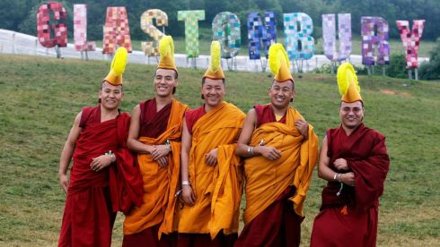 The Gyuto Monks of Tibet pose for a photograph. The Monks, who are signed to Decca Records, took a break from their tour in Australia with the Dalai Lama to perform at the festival's Green Fields. Photograph: Jim Ross/PA Wire