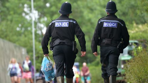 A policeman carries a packet of toilet paper during the first performance day of the festival. Photograph: Anthony Devlin/PA Wire