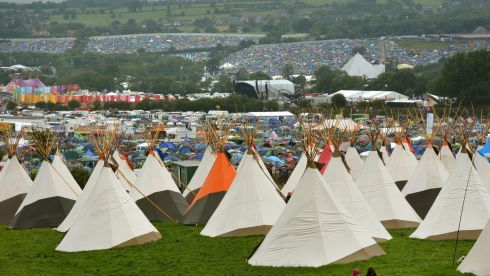 A general view of a sea of tents in the rain during the second day of the Glastonbury 2013 Festival of Contemporary Performing Arts. Photograph: : Anthony Devlin/PA Wire