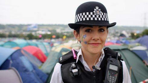 Special constable Sandie Davies, poses for a photograph at  the Glastonbury Festival site.  Asked what the Glastonbury Festival meant to her, the 20-year-old said,'Meeting new people and a great chance to engage with the community'. The festival, which started in 1970 when several hundred hippies paid £1 Stg to watch Marc Bolan, now attracts more than 175,000 people over five days.  Photograph: Matt Cardy/Getty Images