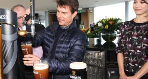 Tom Cruise at one of Dublin's biggest tourist attractions, the Guinness Storehouse, alongside fellow actor Olga Kurylenko and Guinness Master Brewer Fergal Murray.  Photograph: Leon Farrell/ Photocall Ireland