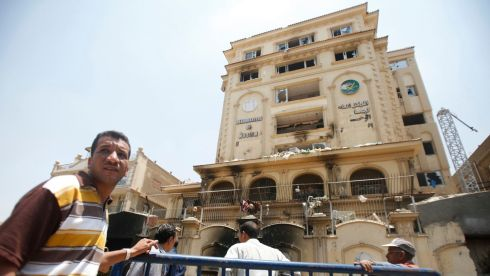 People stand near the Muslim Brotherhood's national headquarters. Photograph: Amr Abdallah Dalsh/Reuters