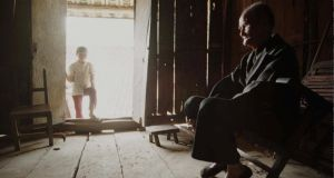 An elderly man in his house in Guangxi province. Photograph: Greg Baker/AP Photo