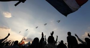 Military helicopters fly above Tahrir Square while protesters opposing Egyptian President Morsi shout slogans against him and Brotherhood members during a protest in Cairo yesterday. Photograph: Mohamed Abd El Ghany/Reuters
