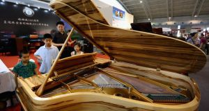 The Steinway & Sons piano zone at the Luxury China 2013 exhibition  in June in Beijing.  Photograoh:  Feng Li/Getty Images