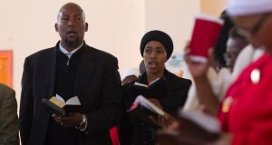 Mandla Mandela, grandson of former South African President Nelson Mandela, sings during a church service near the home of the former president in Qunu.