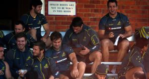 Australian captain James Horwill (top right) laughs with his team mates at a training session in Sydney.
