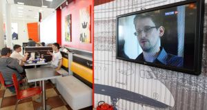 A television screen shows former US spy agency contractor Edward Snowden during a news bulletin at a cafe at Moscow's Sheremetyevo airport last week. Photograph:Sergei Karpukhin/Reuters