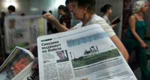 Newspapers in Moscw are distributed with photographs of former US whistleblower  Edward Snowden. Photograph: Reuters