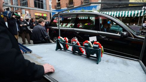 Stalls on Moore street come to a standstill as the funeral of  Mary Kavanagh - May Gorman, Queen of Moore Street as she was known to many,passed her empty stall. She was born on the street in 1921 and sold from her stall from the age of 7 up untill 3 years ago.  Photo: Alan Betson / THE IRISH TIMES