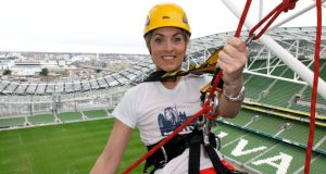 Kathryn Thomas abseils from the top of the Aviva Stadium during the launch of the inaugural Dublin Adventure Race. Photograph: Brendan Duffy