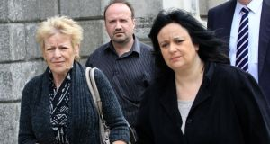 Lydia Acton (left), widow of Peter Acton, Mr Acton's son-in-law John Burke, and Lisa Acton, Mr Acton's daughter, after their High Court action. Photograph: Collins Courts