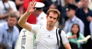 Andy Murray waves to the crowd as he leaves the court following his victory over Fernando Verdasco of Spain at Wimbledon. Photograph: Dennis Grombkowski/Getty Images