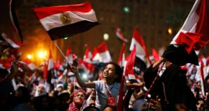 Opponents of Egypt's Islamist President Mohammed Morsi celebrate the military coup in Tahrir Square, Cairo, tonight.Photograph: Suhaib Salem/Reuters
