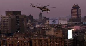 An Egyptian military helicopter flies over Tahrir Square in Cairo as dusk this evening after a broadcast by the head of the Egyptian military that Mohamed Morsi was being removed as national president. Photograph: Spencer Platt/Getty Images