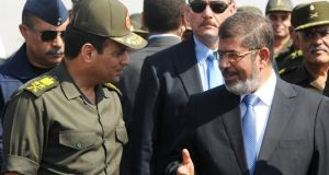Egypt's president Mohamed Morsi (right) with defence minister Abdel Fattah el-Sisi last October. Photograph: Reuters