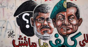 Graffiti of Egyptian President Mohammed Morsi on the walls of Egypt's Presidential Palace in the suburb of Heliopolis on yesterday in Cairo.
