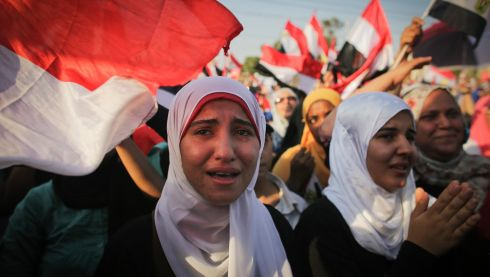 A girl cries during an anti-Morsi rally near the presidential palace in Cairo, July 3, 2013.  Photograph: Tara Todras-Whitehill/The New York Times