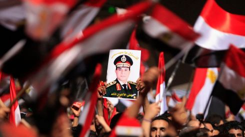 Protesters, who are against Egyptian President Mohamed Mursi, hold a poster featuring the head of Egypt's armed forces General Abdel Fattah al-Sisi in Tahrir Square in Cairo. Photograph: Mohamed Abd El Ghany/Reuters