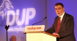 The DUP Social Development Minister Nelson McCausland has rejected the central allegations contained in a BBC Spotlight programme, while the DUP has stated it will sue the BBC over the programme.