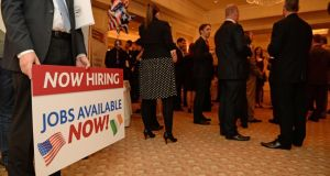 A sign relating to jobs from US investment in Ireland at the American Chamber of Commerce in Ireland annual Independence Day lunch in the Four Seasons Hotel, Dubin. US jobs data showed 195,000 new posts were filled last month. Photograph: Frank Miller/The Irish Times.