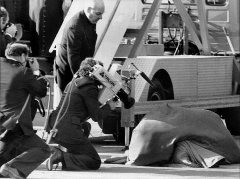Going undercover: the wind blew Pope John Paul II's outer garment over his head as he kneeled to kiss the ground on his arrival at Dublin Airport. Photograph: The Irish Times