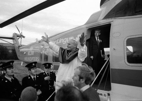 Pope John Paul II salutes the crowd while alighting from a helicopter in Drogheda. Photograph: The Irish Times