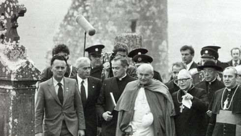 Pope John Paul II being shown around the monastic grounds at Clonmacnoise on his way to Galway.  He requested the visit, believing the monks from Clonmacnoise brought the Christian faith to Poland. Photograph: The Irish Times