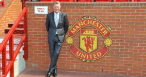 New Manchester United manager David Moyes  in the home team dug out  at Old Trafford. Photograph:  Martin Rickett/PA