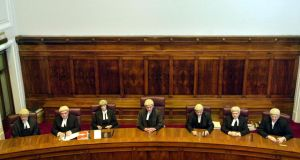 Supreme Court judges at  an appeal by the State against a landmark decision in favour of Kathryn Sinnot and her son Jamie, who has autistm, in 2001. It was the first time seven Supreme Court judges had assembled to determine a constitutional issue. From left: Hugh Geoghegan, John Murray, Susan Denham, the then chief justice Ronan Keane, Frank Murphy, Adrian Hardiman and Nial Fennelly. Photograph: Bryan O'Brien