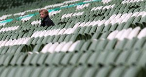 Michael Pentland aged 10 from Belfast, Northern Ireland watches a Carling Cup game from an empty stand. Photograph: Cathal Noonan/Inpho