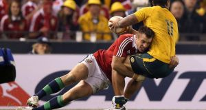 British and Irish Lions Tommy Bowe tackles  Australia's  Joe Tomane during the second Test. Photograph: Billy Stickland/Inpho